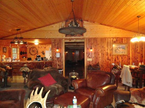 North Mountain Outfitter: Inside the bunk house - rustic decor, wood stove, cozy living room
