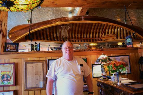 Great Outdoors Restaurant : Canoes, pecky cypress, tin ceiling, fireplace lend a lodge-like feel