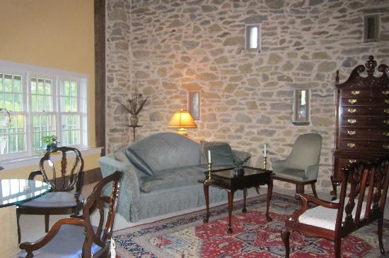 Pheasant Run Farm : large living room with stone wall