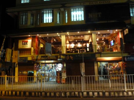 cafe shillong on the first floor, buy some sweets on the way up, top up your phone across the ro