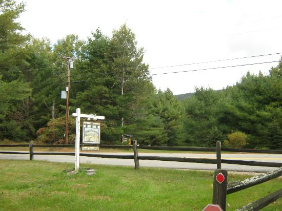 Rumford Center, ME: This is the front entrance by the road. Across the street are the mountains and woods.
