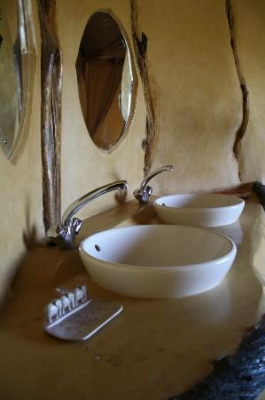 Amani Mara Camp: Fresh bath water from the natural spring. Fresh hot water from solar powered panels.