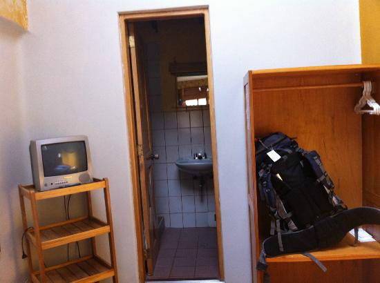 Andenes de Saphy : T.V, closet and Bathroom entrance.