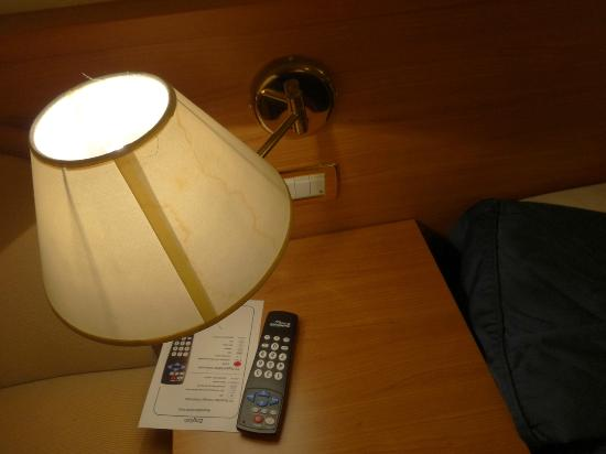 Hotel Axial: Stained lampshade by the bed