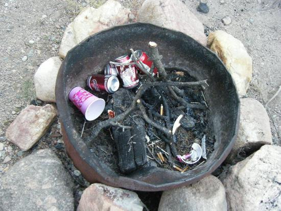 Prospectors RV Resort: Campsite not clean before our arrival... trash in fire pit.