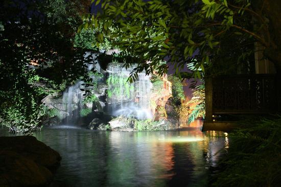 Khum Phaya Resort & Spa, Centara Boutique Collection: Waterfall and fish pond at night.