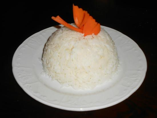 "Thai Orchid Restaurant: Thai Orchid: Rice with ""flying bird"" of carved carrot."