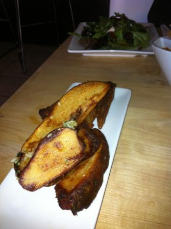 Meze 119: potato wedges w/ parsley and garlic