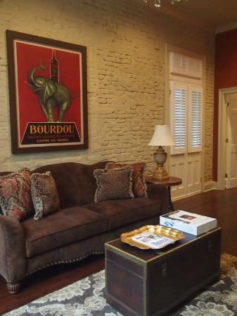 Audubon Cottages: Sitting room that looks like a designer house - love the red framed elephant for just one detail