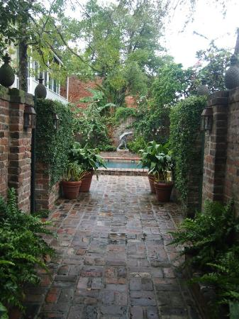 Audubon Cottages: view from the entrance gate to the cottages courtyard & pool - 1st to the right Liz Taylor's pic
