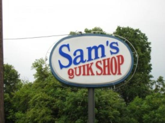 Sam's Quik Shop: Store sign from the road