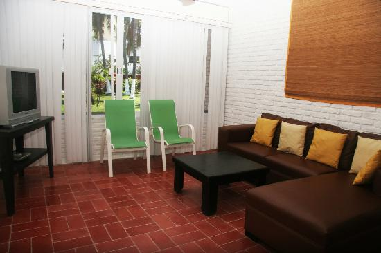 Villa Serena Vacation Rentals: Living room with view to garden area and swimming pool