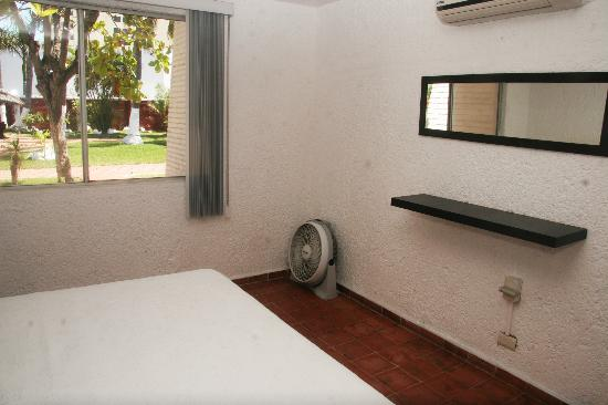 Villa Serena Vacation Rentals: Bedroom with view to garden area & swimming pool