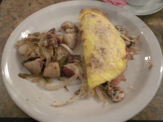 "BEST WESTERN PLUS Heritage Inn: M-F the complimentary breakfast menu also includes a ""special"" such as this omelet."