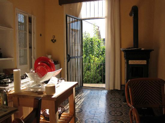 Casa Rosaleda: Part of the living room/kitchen, including the woodstove.