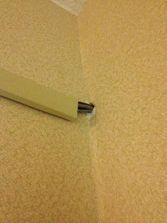Comfort Inn: They just punched holes in walls to run wires!