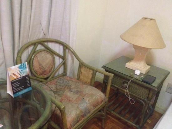 CENTURY HOTEL Angeles City Standard Room, bedside table with lamp and indoor table & chair