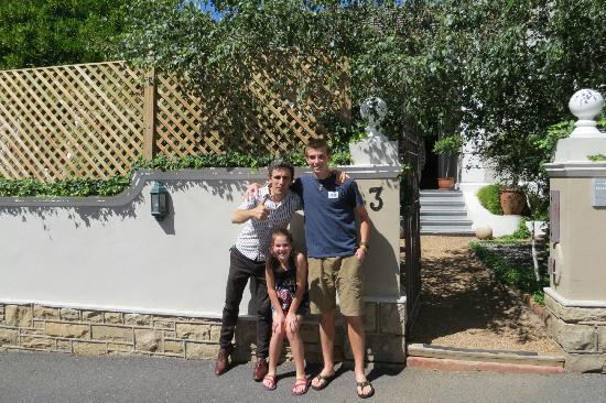 Our host Phil and the kids in front of Parker Cottage