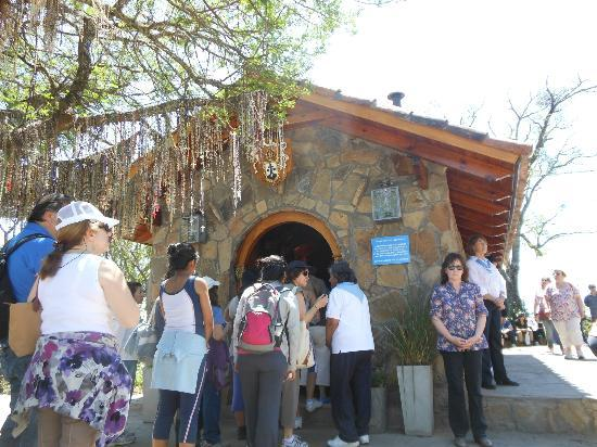 Virgen de los Tres Cerritos: going into The Chapel. See the rosary beads hanging everywhere specially from the trees
