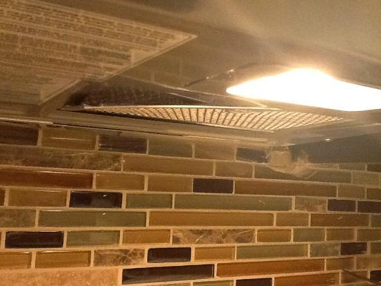 Staybridge Suites Hamilton - Downtown : Extractor hood - falling apart or not put in properly in the first place?