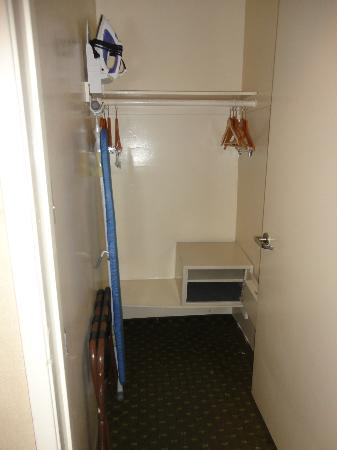 Avenue Hotel: Closet space, with Iron and Ironing Board and Safe