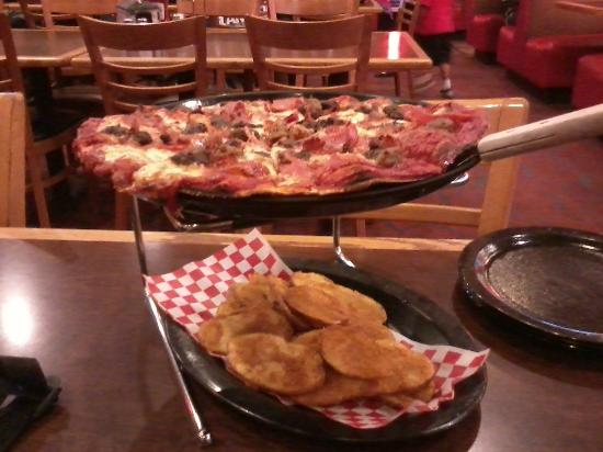 Shakey's: Medium Ultimate Meat, with an order of Mojo Potatoes