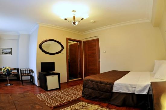 The Sunrise Hotel: room