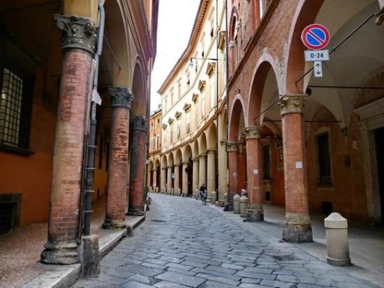 Emilian Land Tour: Narrow street lined with colonnades