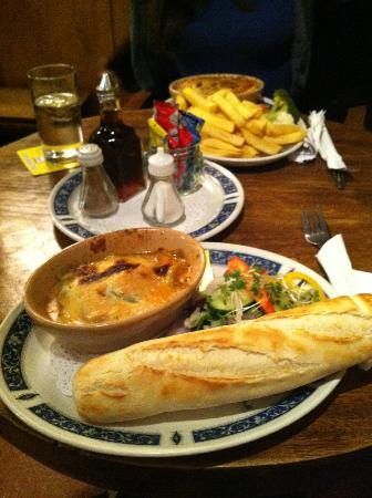 Warren House Inn: Beef lasagne in foreground and rabbit pie in the background