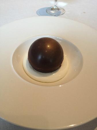 Petrus: Chocolate sphere with milk ice cream and honeycomb