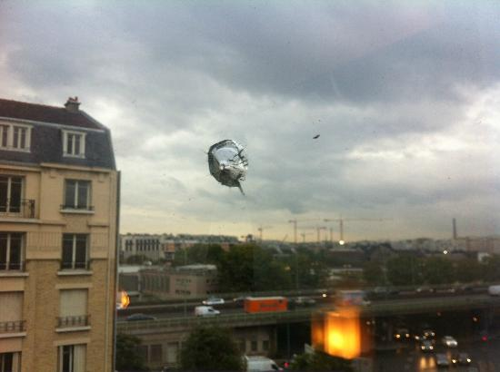 Holiday Inn Paris-Porte De Clichy: luckily the bullet only went through the outer pane of glass!