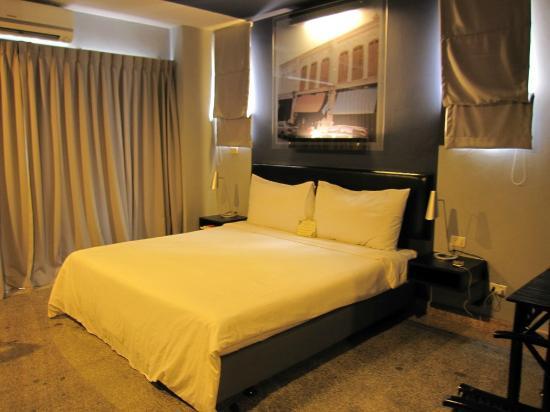 Sino Inn Phuket: เตียงนอนภายในห้องพัก