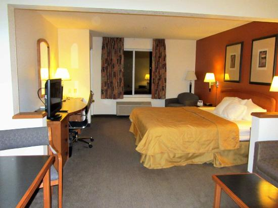 Sleep Inn & Suites Lebanon / Nashville: King Suite - large room with large desk and couch and small dinning table