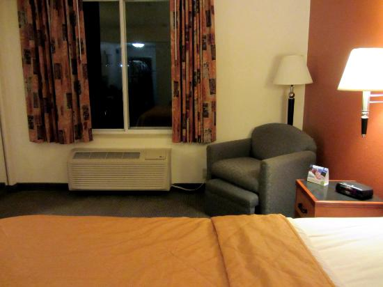 Sleep Inn & Suites: Sitting chair has a pull out footstool, tucks away when not in use