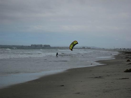 Kite surfer at Silver Strand State Beach on a cloudy day