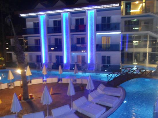 Ocean Blue High Class Hotel : Hotel pool area lit up at night