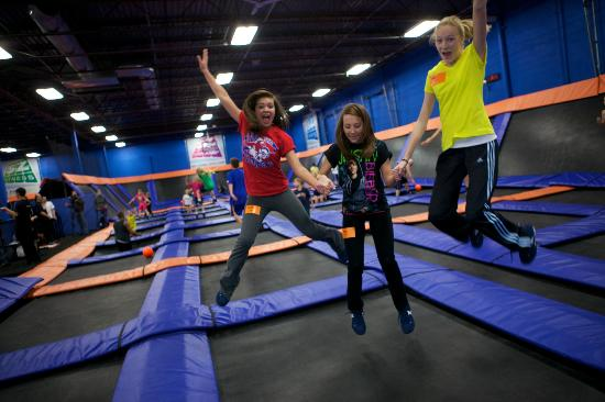 Image result for moms bouncing on indoor trampolines