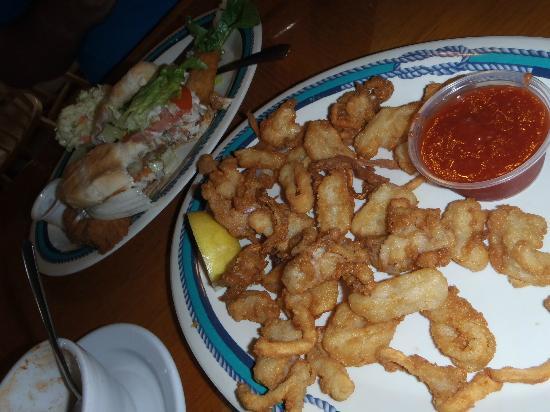 Fish Tales Market & Eatery: Dolphin sandwich, calamari appetizer