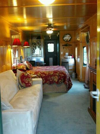 Red Caboose Getaway: Grape Escape. Beautiful, Classy, Comfortable decor.