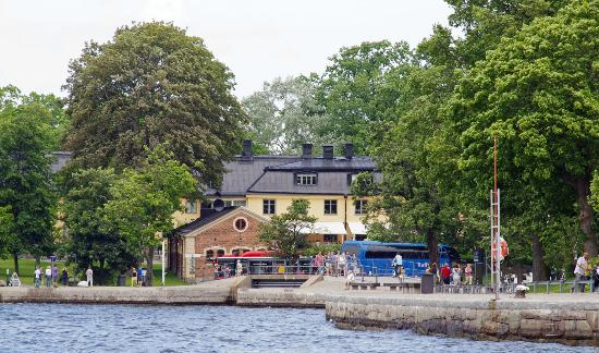 Hotel Skeppsholmen: View from a ferry across heritage buildings to the hotel