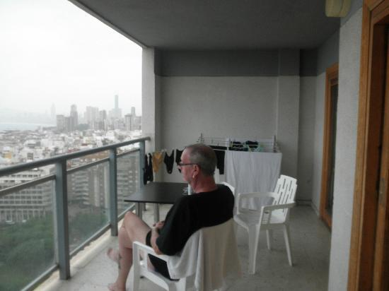 La Era Park Apartments: Watching the rain from the balcony