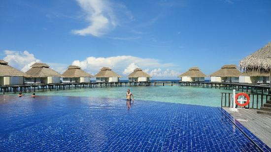 Ellaidhoo Maldives by Cinnamon: View over pool toward water bungalows