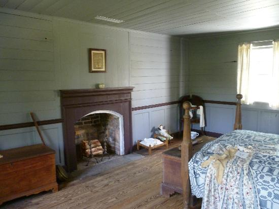 House in the Horseshoe: View of bedroom with bullet holes in tn the wall