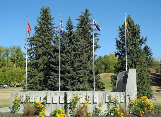 Dedication plaza with flags of the provinces, territories at Confederation Park, Calgary