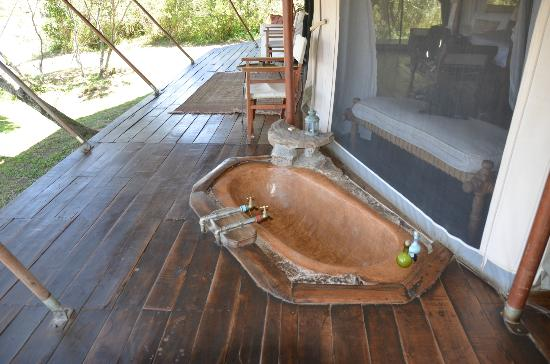 ‪‪Ngare Serian‬: Copper bathtub on the deck with view of hippos