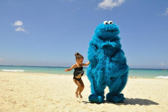 Beaches Negril Resort & Spa: Sesame Street Cookie Monster on the beach with our Grand Daughter.