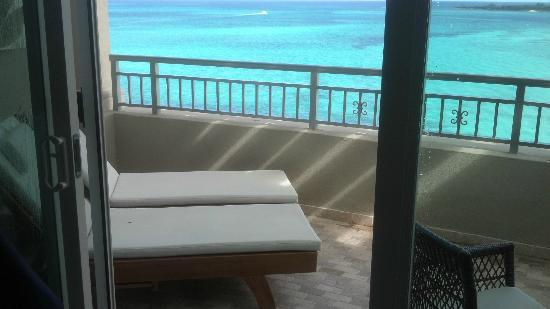 Sandals Royal Bahamian Spa Resort & Offshore Island: Our loungers on oversized deck dining table for two to the right !