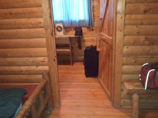 Moab KOA Campground: going into the back room where there's 2 sets of bunk beds and a little desk/table and two windo