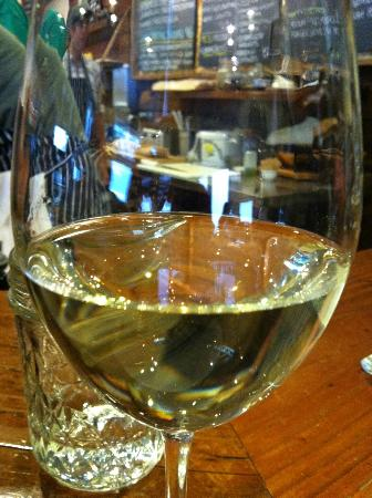 The Cheese Shop: Wine by the glass or bottle. Fun & interesting beers too!