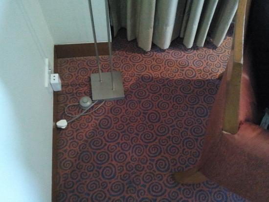 The Raintree Hotel, St.Mary's: Outlet meant for floor lamp used to recharge mobile phone